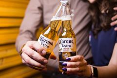 Corona extra beer. Kiev,Ukraine - Feb 9, 2018: Corona Extra, one of the top-selling beers worldwide is a pale lager produced by Cerveceria Modelo in Mexico stock images
