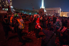 KIEV, UKRAINE - February 20, 2014: Euromaidan protesters breaking paving slabs Royalty Free Stock Photos
