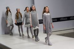 Kiev, Ukraine - February 08, 2018: Children demonstrate fashionable clothes for children on the podium royalty free stock photos