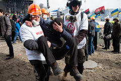 KIEV, UKRAINE - February 19, 2014: Mass anti-government protests. In the center of Kiev. Volunteers help the wounded after on Independence Square after a night Stock Image