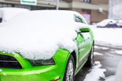 Kiev, Ukraine - February 09. 2018: Powerful Ford Mustang Boss edition parked outdoor under snowfall at bright winter day stock photos