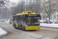 Kiev, Ukraine - February 24, 2018: Trolleybus on a snowy street royalty free stock images