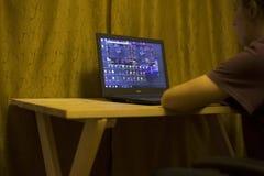 Kiev, Ukraine 05.12.2019 : girl playing online poker for laptop  Illustrative Editorial stock photography
