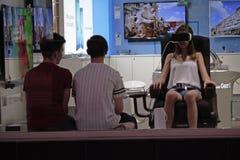 Kiev, Ukraine - Girl trying on virtual reality glasses in a Sams. Ung brand store on Khreshchatyk Street Royalty Free Stock Photos