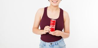 KIEV, UKRAINE - 06.28.2018: Happy woman holding iced glass of Coca Cola isolated on white background. Copy space stock photos