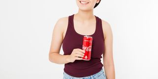 KIEV, UKRAINE - 06.28.2018: Happy woman holding iced glass of Coca Cola isolated on white background. Copy space royalty free stock photos
