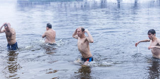 Kiev,Ukraine - Jan.19, 2017 : Orthodox Christians celebrate Epiphany with ice swimming.girl Praying girl Royalty Free Stock Images