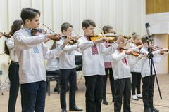 Kiev, Ukraine. January 21 2019 Children's violin ensemble. Children with violins on stage. Children's initiative, small talents. stock photos