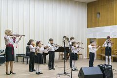 Kiev, Ukraine. January 21 2019 Children's violin ensemble. Children with violins on stage. Children's initiative, small talents. stock images