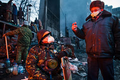 KIEV, UKRAINE - January 26, 2014: Euromaidan protesters rest and Royalty Free Stock Photo