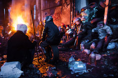 KIEV, UKRAINE - January 26, 2014: Euromaidan protesters rest and Royalty Free Stock Photo
