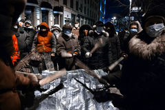 KIEV, UKRAINE - January 20, 2014: Mass anti-government protests. In the center of the Ukrainian capital Kiev. People on Hrushevskoho St. preparing to storm by Stock Photography