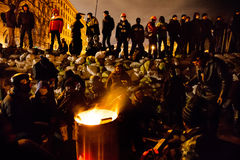 KIEV, UKRAINE - January 24, 2014: Mass anti-government protests. In the center of the Ukrainian capital Kiev. Waiting to storm by government troops on Royalty Free Stock Photos