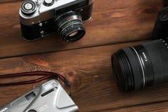 Kiev, Ukraine - January 21, 2019: Three cameras on a wooden background. Canon camera royalty free stock photo
