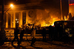KIEV, UKRAINE - January 20, 2014: Violent confrontation and anti Royalty Free Stock Photos