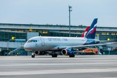 KIEV, UKRAINE - JULY 10, 2015: Aeroflots SSJ 195. KIEV, UKRAINE - JULY 10, 2015: Aeroflot SSJ 195-b taxis to teminal at KBP Airport on January 12, 2014. Aeroflot royalty free stock images