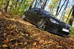 Kiev, Ukraine, July 13, 2015. BMW M6 in autumn forest. royalty free stock images