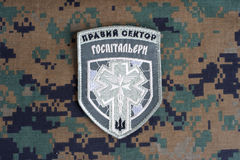 KIEV, UKRAINE - July, 08, 2015. Chevron of Ukrainian volunteers corps with the words Stock Photography