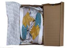 KIEV, UKRAINE - July 17, 2017: New sports sneaker REEBOK X FACE STOCKHOLM BOLTON in the box. Unpacking Stock Photo
