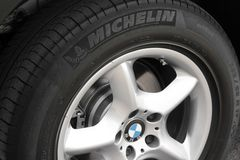 Kiev, Ukraine - July 27, 2018: Part of the gray car BMW X5. Car wheels close up on a background of asphalt royalty free stock image