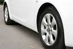 Kiev, Ukraine - July 2, 2018: White Opel Insignia, view of the car from the bottom. Car wheels close up on a background of asphalt stock images