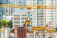 Kiev, Ukraine - July 4, 2018: Workers are working at a construction site. Concrete and roofing construction work is carried out. Royalty Free Stock Photo