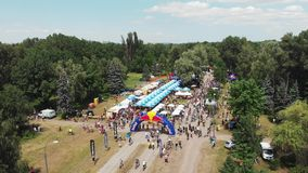 Kiev/Ukraine-June,1 2019 Aerial drone view of recreational and playing area in green park with finish line at Bike day stock footage