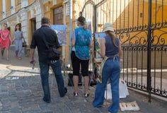 Kiev, Ukraine - June 16, 2016: Artists paint a cityscape on the stree Stock Images