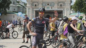 Kiev/Ukraine-June,1 2019 Attractive cyclist smiling and waving a hand. Portrait of cute young boy in cycling apparel and sunglasse stock video footage