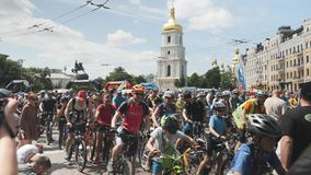 Kiev/Ukraine-June,1 2019 Group of bike riders in city center at bike day. Participants of cycling parade riding near square in Kyi stock video footage