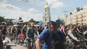 Kiev/Ukraine-June,1 2019 Group of cyclists are starting bicycle parade. Young attractive men and women riding on bikes in city cen stock video