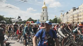 Kiev/Ukraine-June,1 2019 Group of cyclists are starting bicycle parade. Young attractive men and women riding on bikes in city cen stock video footage