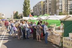 Kiev, Ukraine - June 10, 2018 People stand in a long queue for food in the market stock images