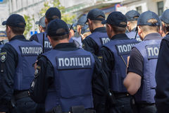 Kiev, Ukraine - June 12, 2016: Rows of Ukrainian policemen prote. Cting participants out gay parade Royalty Free Stock Images