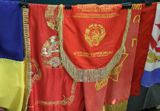 Kiev, Ukraine - June 04, 2016: Soviet flags and pennants are sold at the flea market. Inscription on the flag: `To the collective - the winners of the Stock Photo