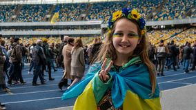 Kiev, Ukraine - 04.14.2019. Little Ukrainian girl. A crowd of Ukrainians are going to the stadium to support the presidential royalty free stock photography