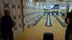 Bowling machine, bowling strike. Kiev, Ukraine, March 10 2017. Bowling club. bowl rolls along the bowling track and strikes a strike stock video