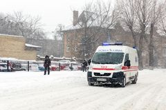 Kiev, Ukraine - March 1, 2018. Heavy snowfalls , frost and blizzard in Eastern Europe. Traffic jam. Ambulance hurrying to rescue t Stock Photography