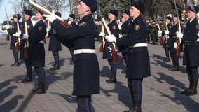 The honor guard of the Ukrainian army shows tricks with weapons. Young soldiers are armed with weapons. Kiev, Ukraine - March 22, 2018: The honor guard of the stock footage