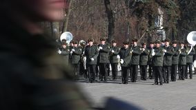 The honor guard of the Ukrainian army shows tricks with weapons. Young soldiers are armed with weapons. Kiev, Ukraine - March 22, 2018: The honor guard of the stock video footage