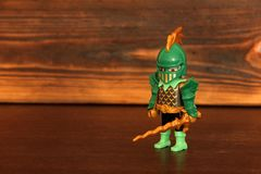Kiev, Ukraine - March 13, 2019: Lego figures. Knight on wooden background royalty free stock photography