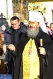 Kiev, Ukraine, March 12.2016. Metropolitan of Kiev Onufry conducting St. Cyril`s Monastery and covers people with holy water Royalty Free Stock Photography