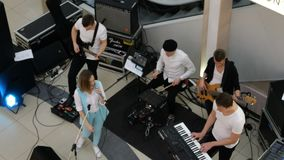 Unidentified musicians entertain customers in the Sky Mall supermarket. Kiev, Ukraine, March 2019: - Unidentified musicians entertain customers in the Sky Mall stock video footage