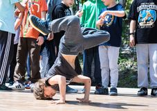 KIEV, UKRAINE - MAY 28, 2017: Street artist breakdancing outdoors Royalty Free Stock Photography