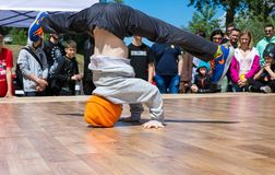KIEV, UKRAINE - MAY 28, 2017: Street artist breakdancing outdoors Stock Photos