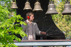Kiev, Ukraine - May 05, 2016: Bell-ringer play on the set of bells Royalty Free Stock Photo