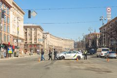 Kiev,Ukraine - May 06, 2017:Central street of ukrainian capital Kyiv Khreschatyk closed for traffic by police car and. Officer. Pedestrian area in centre stock photo