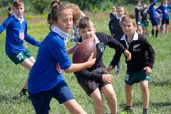 Kiev, Ukraine - May 9, 2018: Children play rugby in retro form at the festival stock photos