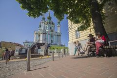 Kiev, Ukraine - May 19, 2019: Citizens and tourists near the Andrew`s Church. Kiev, Ukraine - May 19, 2019: Citizens and tourists near the St. Andrew`s Church stock photography