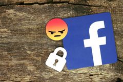 Facebook icon with lock and angry emoji smile Royalty Free Stock Image